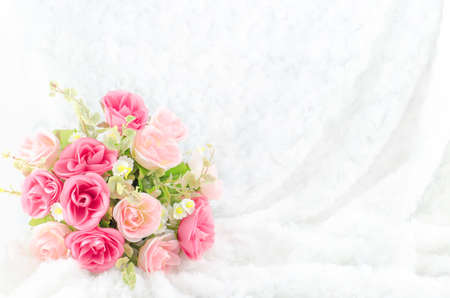 Pastel Coloured Artificial Pink Rose Wedding Bridal Bouquet on white fur background with soft vintage tone Stockfoto