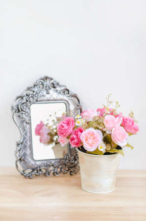 rose coloured: Pastel Coloured Artificial Pink Rose Wedding Bridal Bouquet in flower pot with reflection from retro mirror