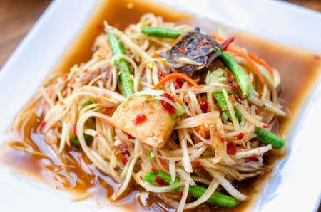 somtum: Thailand Food - Spicy Papaya Slalad with chili, garlic, lime juice and herb - Som Tum