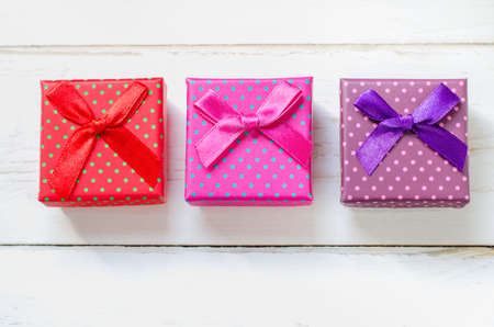 boxs: Colorful gift boxs on white wooden table, Pink, Red, Purple