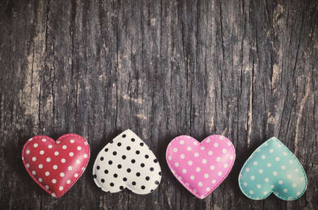 Retro heart with white dot pattern on old wooden table with vintage and vignette tone - Love Concept 写真素材