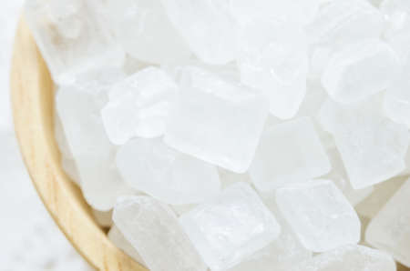 crystalline: Close up of white crystalline sugars in wooden bowl Stock Photo
