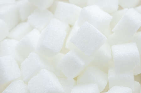 refined: Close up of white cube refined sugars texture background Stock Photo