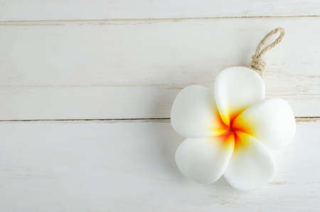 Spa aromatherapy soap with Plumeria flower shape on white vintage wooden table Stock Photo