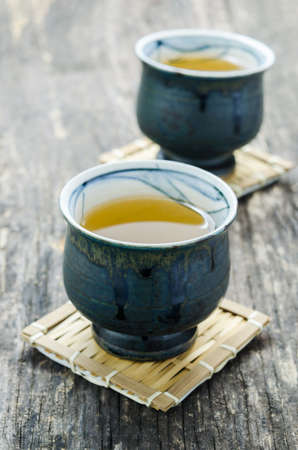 japanese green tea: Cup of Japanese green tea on old wooden table