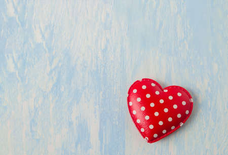 Close up of red retro heart with white polka dot pattern on blue vintage wooden background - Valentine background Stock Photo