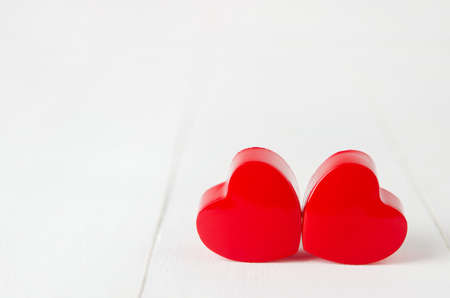 Close up of couple red heart on white wooden background - Valentine background