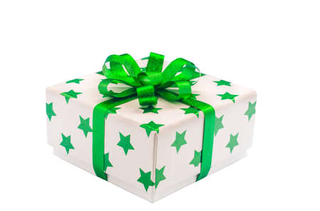 Whie gift box with green star pattern and green ribbon bow isolate on white background with clipping path