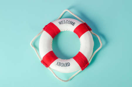 Small red and white lifebuoy on blue background