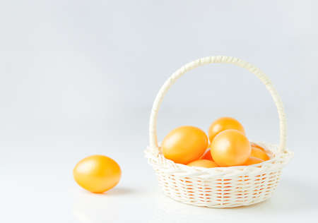 Close up of golden easter eggs at white basket on white 写真素材 - 145955655