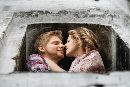 rubbing noses: Couple in window opening is about to kiss