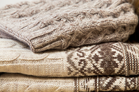 Close up of folded woolen clothes in beige photo