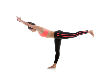 warrior girl: Sporty yoga girl on white background in virabhadrasana 3 (Warrior 3 Pose) Stock Photo