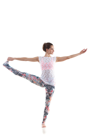 hasta: Smiling yoga girl on white background in hasta padangushthasana (stretched hand grasps big toe)