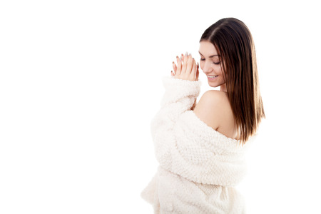 undress: Beautiful sexy young woman taking off white bathrobe, undress exposing shoulders, isolated. Cozy, beauty, comfort, wellbeing, healthcare, bodycare, purity concepts Stock Photo
