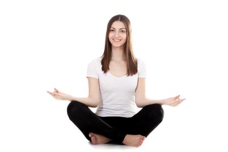 sukhasana: Sporty yogi girls exercise in lotus position, Yoga pose sukhasana (Easy Pose, Decent Pose, Pleasant Pose) with palms in Mudra, sitting squat cross-legged. Isolated on white background