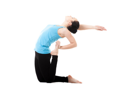 Sporty yogi girl doing fitness exercises, Backbend, asana Ustrasana (ushtrasana, Camel yoga Pose), isolated on white background