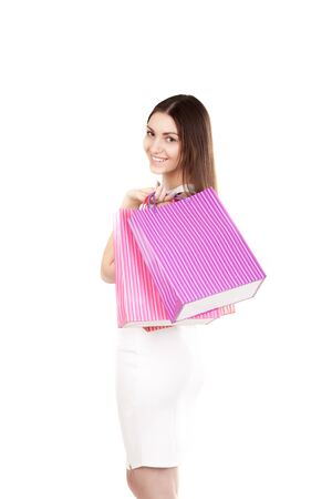 consumerism: Smiling female holding colorful shopping bags, isolated on white background. Concepts: sales, rest, stress-therapy, consumerism