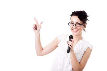 Presentation, public speech, conference, broadcasting, advertisement. Beautiful young businesswoman, reporter, TV presenter holding microphone pointing on copyspace, isolated