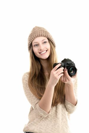 photography: Friendly smiling female photographer holding slr camera, traveling photography, hobby, teenagers activity Stock Photo