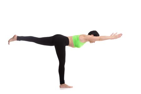 virabhadrasana: Sporty girl on white background doing exercise for legs, balancing in Warrior III posture, Virabhadrasana 3
