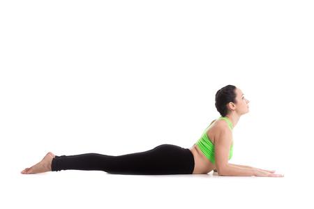 cobra snake: Sporty yoga girl on white background doing easy variation of cobra asana, Sphinx Pose, half Cobra posture, Ardha bhudjangasana (Bhujangasana)