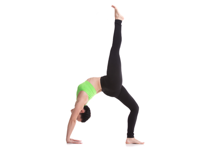 pada: Beautiful sporty girl practices yoga, backbend in One-legged Upward Bow (Wheel) Pose, Eka Pada Urdhva Dhanurasana, asana for flexible spine