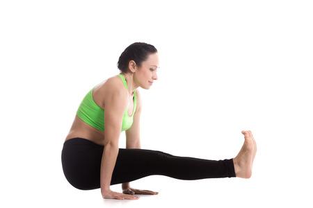 Beautiful sporty girl doing arm balancing yoga training, Utpluti Dandasana (Floating Stick asana), Celibates posture, Brahmachariasana, L sit pose. Strengthening abdominal muscles, thigh, arms Reklamní fotografie