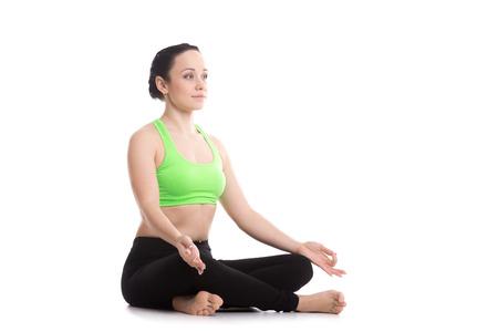 sukhasana: Serene girl practicing yoga, Sitting in Easy (Decent, Pleasant Pose), Sukhasana, asana for meditation, pranayama, breathing, copy space