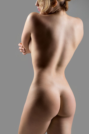 nude women: Close-up of unrecognizable sexy naked beautiful young woman, back view, weight loss, health and skincare concepts