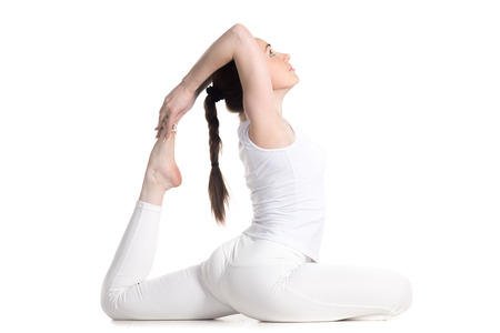 eka: Sporty attractive young woman with braid in white sportswear sitting in variation of One-Legged King Pigeon Pose - Eka Pada Rajakapotasana 1, studio full length profile view, isolated