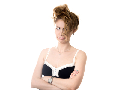 messy hairstyle: Portrait of young attractive blond woman making funny face, annoyed with her bad messy hairstyle and hair problems, studio shot, isolated on white background