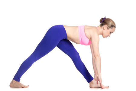 ardha: Sporty attractive young blond woman doing Half Pyramid Pose, Intense Side Stretch Posture, Ardha Parsvottanasana, studio full length isolated shot, profile view on white background