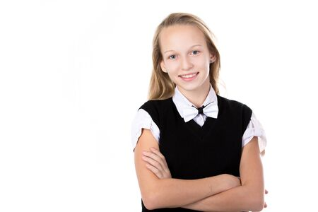 office uniform: Portrait of happy cute beautiful blond schoolgirl wearing black and white formal outfit and bow tie, holding arms folded, posing, friendly smiling, isolated studio, white background, copy space