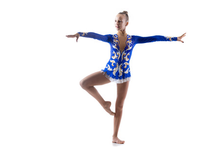 girl working out: Beautiful happy smiling ballerina teenage girl wearing dancer blue leotard working out, dancing, posing, doing art gymnastics exercise, full length, studio, white background, isolated Stock Photo