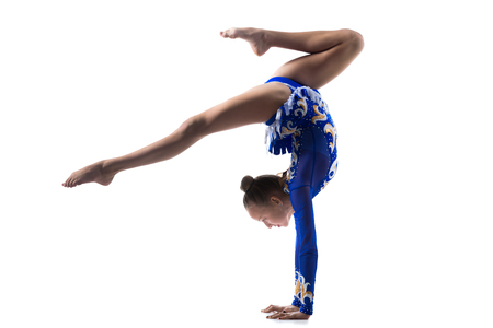 fit girl: Beautiful gymnast athlete teenage girl wearing dancer blue leotard working out, dancing, doing backbend, handstand exercise, back walkover, full length, studio, white background, isolated