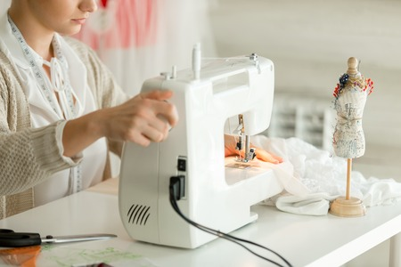 Woman At A Sewing Machine Hands On A Regulator Concept Photo Stunning Hands Free Sewing Machine
