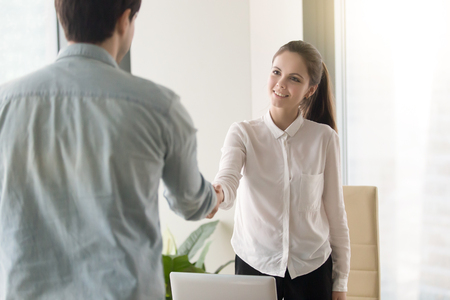 HR manager meeting with job applicant at the office for interview, two smiling business partners making agreement, greeting,handshaking, shaking hands before negotiations. Welcome to our team concept