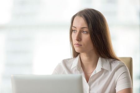 Lost in thoughts businesswoman thinking of solution. Worried female sitting alone in office looking away. Female entrepreneur ponders decision at workplace. Absent minded young woman tired, distracted Stock fotó - 77767693