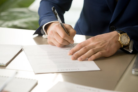 Businessman having signatory right signing contract concept, focus on male hand putting signature on official legal document, entering into commitment, concluding business agreement, close up view Imagens - 83276149