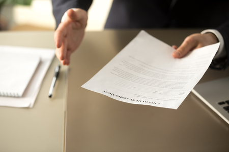 Close up view of employer offering work, businessman extending agreement for signing to successful applicant, hiring new employee concept, assignment, job placement, terms of employment, getting job Stock Photo