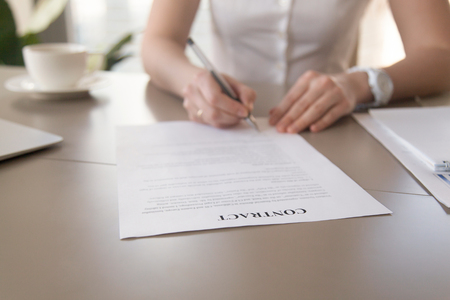 Close Up View Of Businesswoman Signing Business Legal Document - Signing legal documents