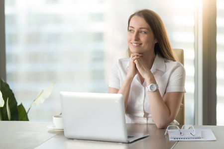 Meditative smiling businesswoman dreaming of future success at workplace, dreamy hopeful woman looking away, feeling anticipation excitement, having plan, positive thinking and visualization, portrait