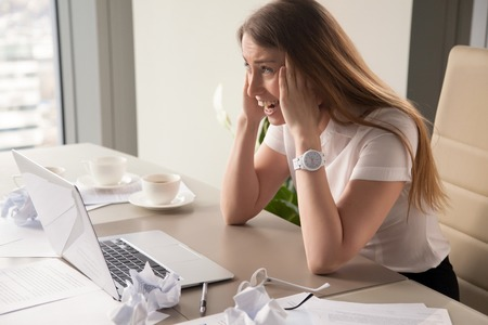 Hysterical woman experiencing burnout at workplace, overwhelming stress, overworked desperate employee screams in panic after missed deadline, too much work, nervous breakdown or emotional exhaustion
