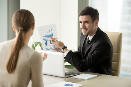 Happy project manager holds financial report, shows rising stats and growing graphs to colleague, satisfied with great development rate, successful strategy, business growth, company success concept