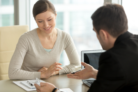 Company executive coaching young personal secretary assistant, team leader or senior manager explaining work duties to junior, businessman telling contractual terms or deal details to female partner Stock Photo