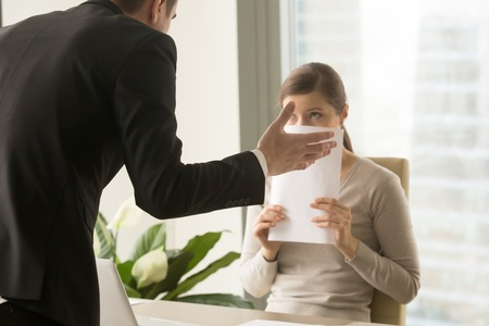 Angry irritated boss reprimanding employee afraid to be fired, accusing of mistake in report, bad work, blaming for incompetence, emotional pressure, stress at work, verbal warning about work failure