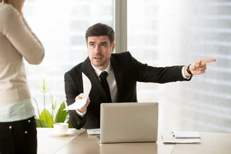 Angry company executive dismisses employee for paperwork error, mad ceo discharges ineffective manager after bad work, furious chief fires subordinate dissatisfied with poor performance, youre fired