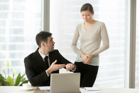 Irritated boss pointing on wristwatch, dissatisfied ceo demanding explanations of female manager, nervous employee making excuses for missed deadline, intern apologizing for being tardy, coming late