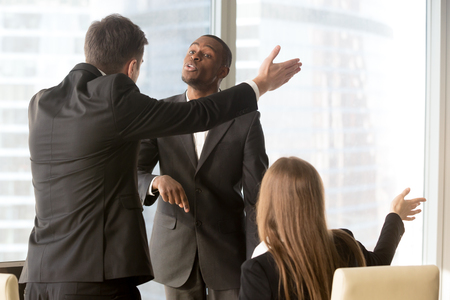 Ambitious african american male candidate insisting on getting a job, male and female caucasian recruiters asking quarrelsome applicant to leave office. Failed interview, conflict at work or dismissal